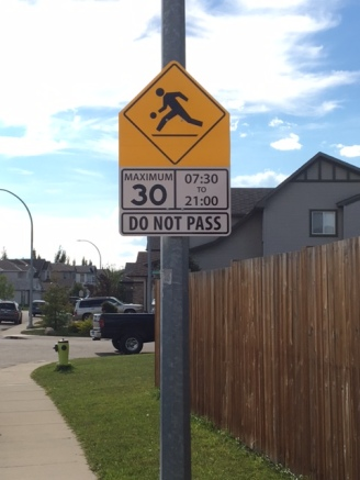 Playground Zone signs are up as are crosswalk signs