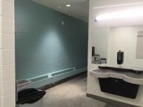 Doorless washroom with sink open to hallway